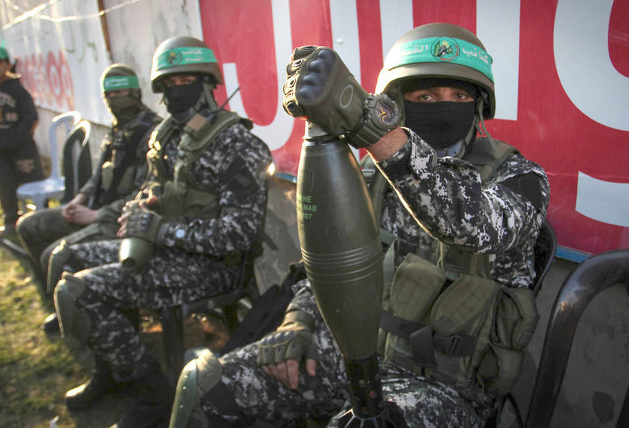 Members of the Ezzedine al-Qassam Brigades, the military wing of the Palestinian Islamist movement Hamas, take part in a rally marking the 29th anniversary of the founding of the movement on Dec. 16, 2016, in Rafah in the southern Gaza Strip.