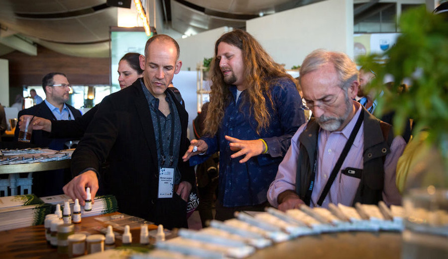 Inside the annual CannaTech medical marijuana innovation conference in Tel Aviv on March 20, Moshe Ihea (center), founder and CEO of Israel-based Cannabliss.