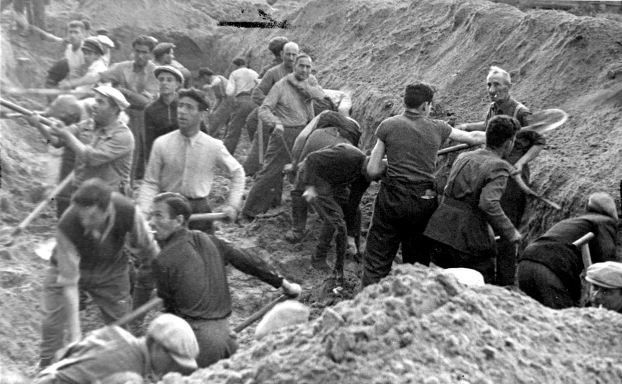 Jews digging a trench in which they were later buried after being shot in Ponary, Poland.