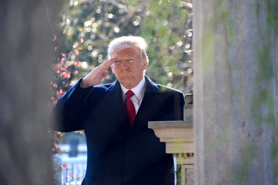 President Trump pays his respect at the grave site and renders a hand salute to former president Andrew Jackson.