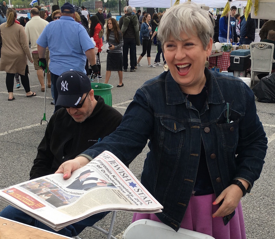 The Jewish Star's Tovah Richler distributes newspapers at Israelfest in Port Washington.