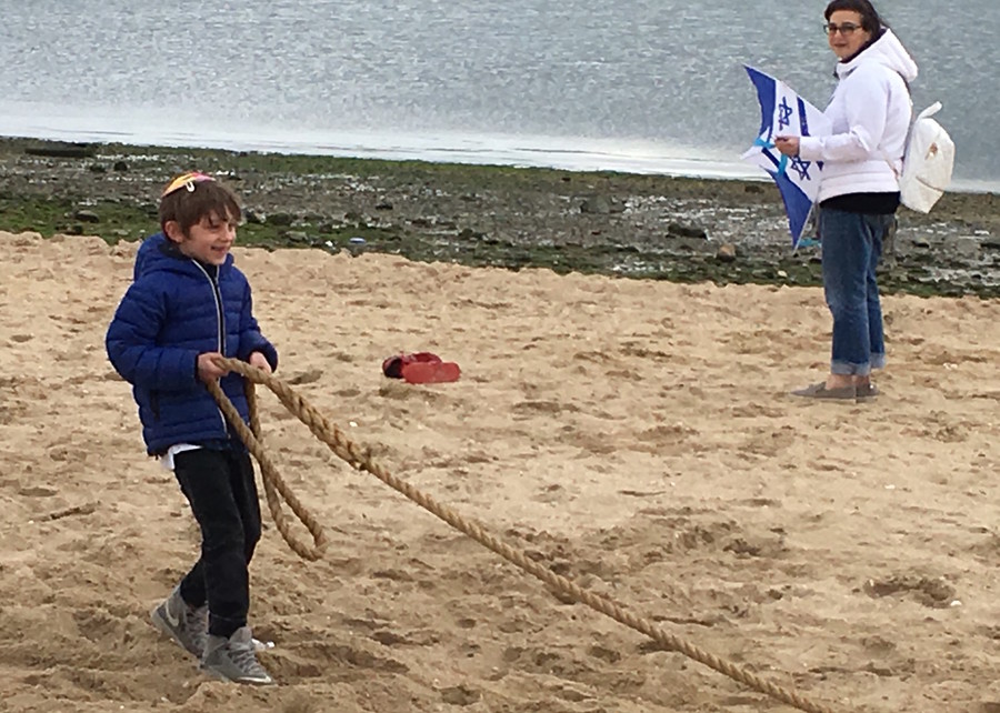"On the temporarily-renamed ""Tel Aviv Beach"" in Port Washington, children flew kites and played tug of war at Israelfest on Sunday, May 7."