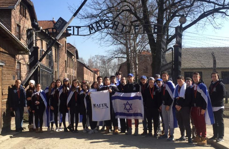 Students from HAFTR outside the main gate of the former Auschwitz extermination camp in Oswiecim, Poland, in May 2017.