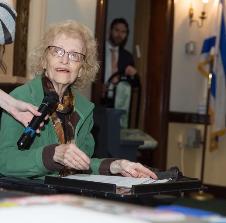 HAFTR HS Yom HaShoah: Mrs. Hizme, a HAFTR grandparent and HILI alumna, delivered testimony on her experiences in Auschwitz and as a victim of Josef Mengele's experiments.