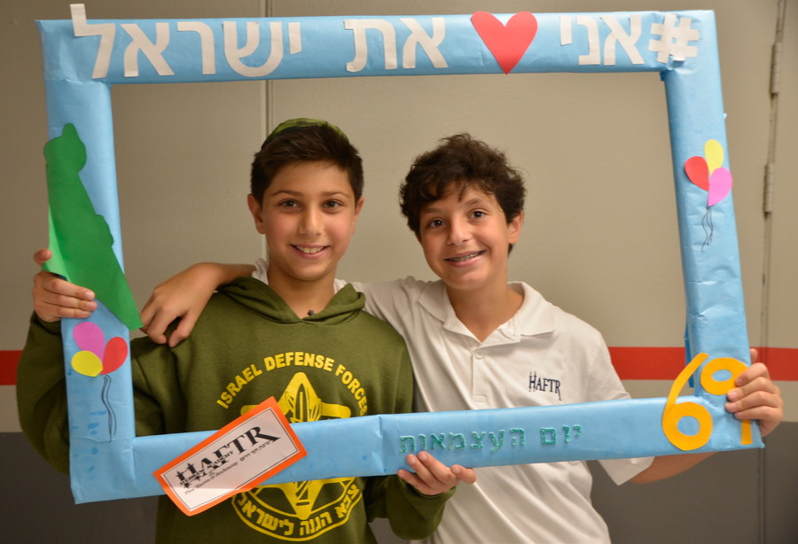 HAFTR Yom HaAtzmut: After pausing on Yom HaZikaron to remember the soldiers who gave their lives to make the State of Israel a reality, as night fell, Arie Assaraf and Eitan Hazan joined the Lower School celebration of Israel independence.