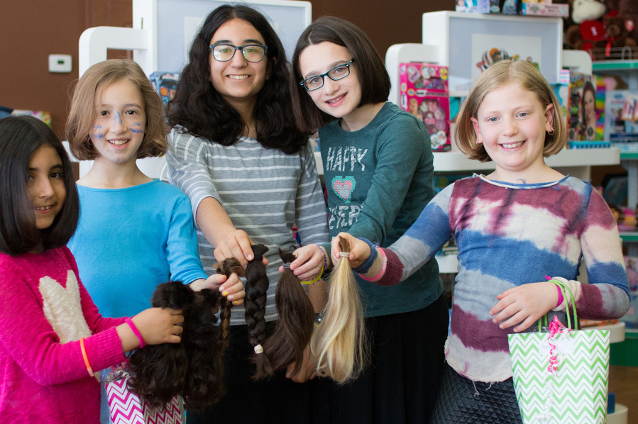 Yeshiva Har Torah hair donations, from left: 2nd grader Maya Goykadosh of Great Neck, 3rd grader Jasmine Nurieli of West Hempstead, 7th grader Hannah Goykadosh of Great Neck, 8th grader Neira Rosenbaum of West Hempstead, and 2nd grader Sonia Kaynan of Jamaica Estates.