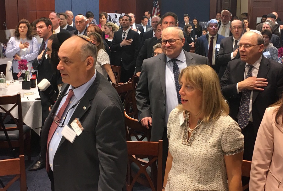 Participants in the Capitol's Jerusalem 50 celebration pledge allegiance to the U.S. as the event began.