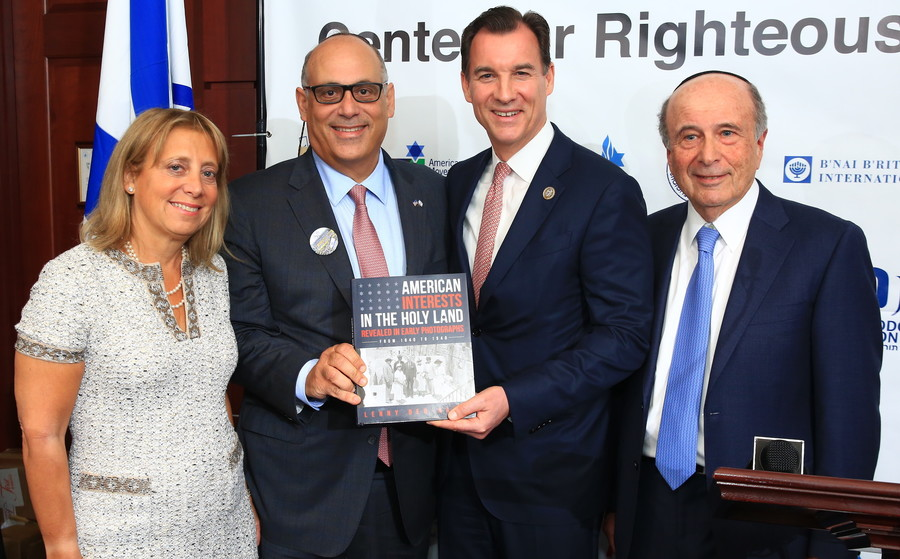 "Five Towners Iris and Shalom Maidenbaum present a copy of ""American Interests in the Holy Land"" by Lenny Ben-David, to Rep. Tom Suozzi (D-NY) of Long Island."