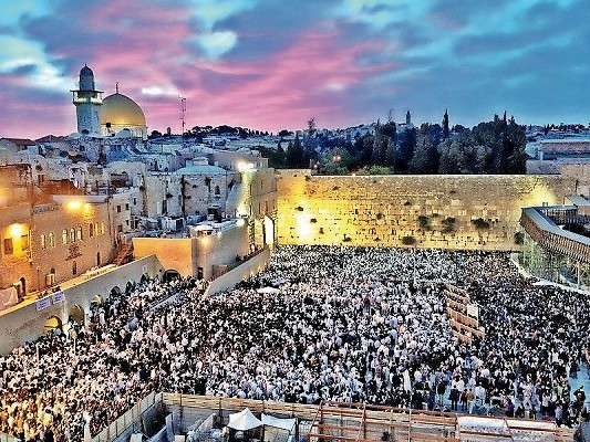 After the Western Wall's liberation in 1967, Jews resumed praying there. This scene is from Shavuot 2012.