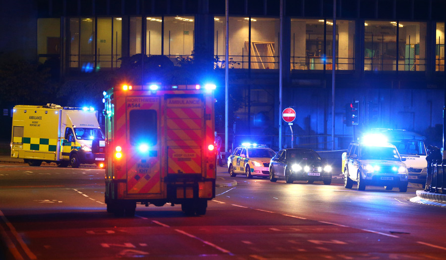 Emergency services arrive  close to the Manchester Arena on May 23.