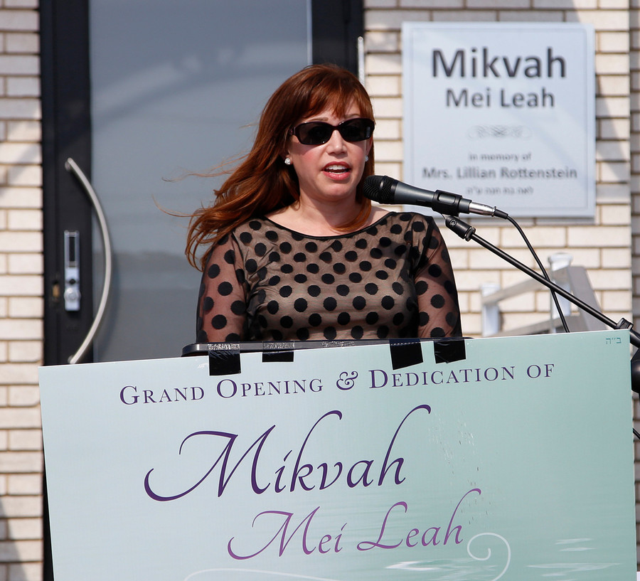 Gayle Benno speaks that the dedication of the Merrick-Bellmore Community Mikvah.