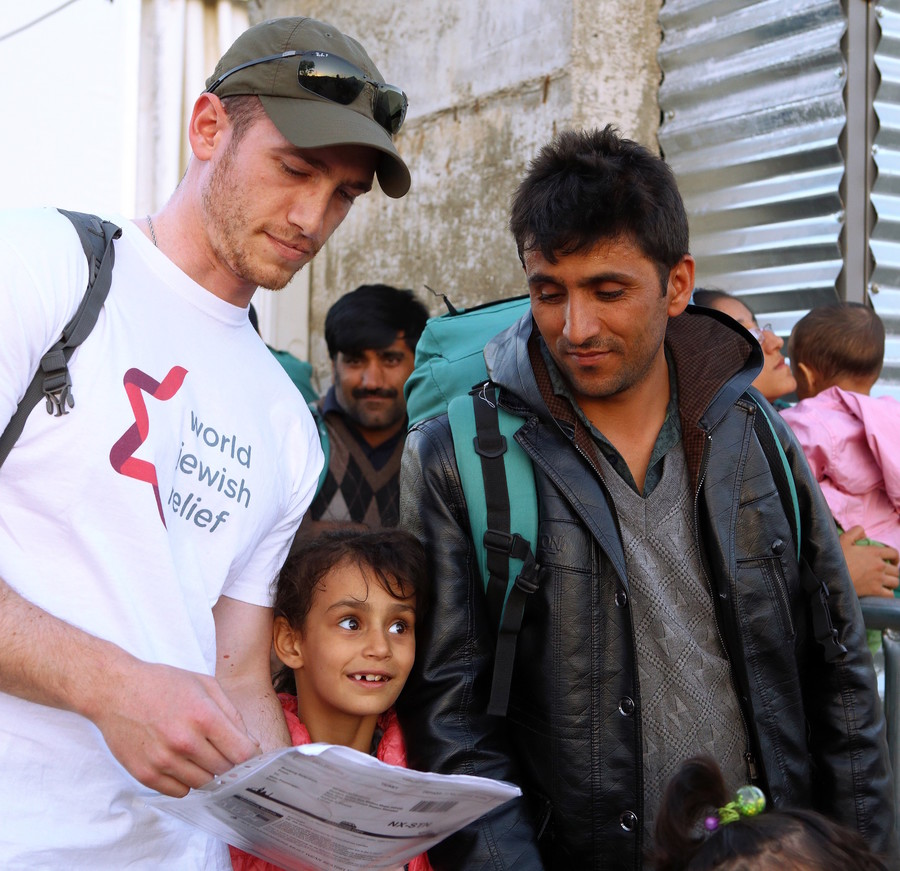 A volunteer with World Jewish Relief works with refugees in Greece.