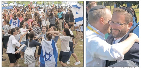 Left, dancing at Ben Gurion. Right, NBN's Rabbi Fass embraces Rabbi Dov Lipman, himself an oleh from America, who was on scene to greet the newest Israelis.