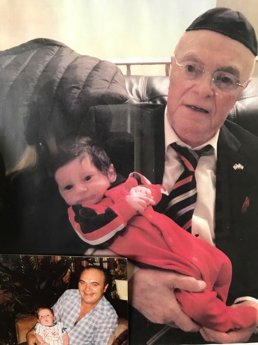 Jack Rybsztajn holds his great-grandson, Isaac. Years earlier, in inset below, he holds his grandson, Marc, who is Isaac's father.