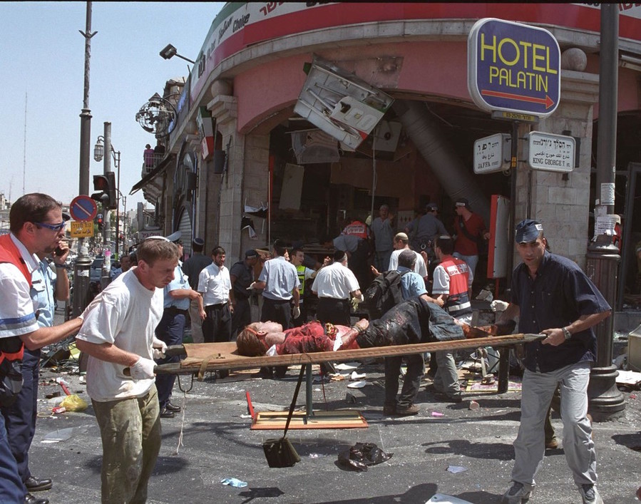An injured girl is evacuated from the scene of the Palestinian suicide bombing at the Sbarro pizzeria in Jerusalem on Aug. 9, 2001.