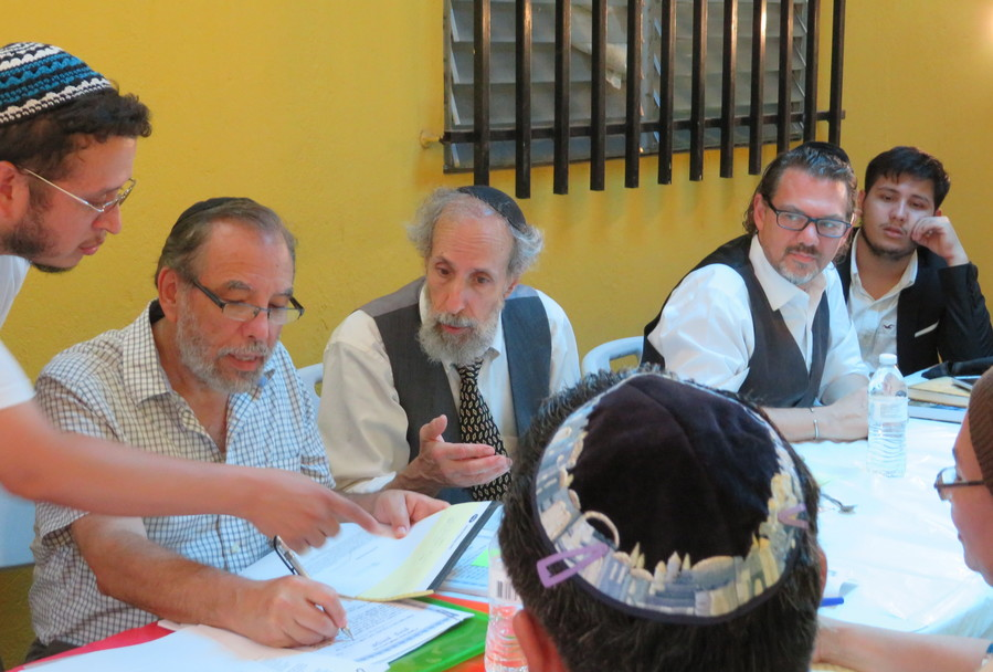 From left: Moshe Omar Cohen-Henriquez speaking with beit din members Rabbi Mark Kunis, Rabbi Andy Eichenholz and Rabbi Marc Phillipe in Managua, Nicaragua, on July 20. At far right is Even Centeno, a convert who traces his ancestry to Sephardi Jews who were forced to convert to Christianity.