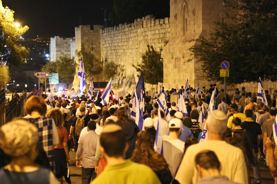 Thousands of Jews marched in a demonstration organized by Women in Green around the walls of Jerusalem's Old City, calling the state to make the Temple Mount under Israeli control and allowing Jews to pray there, on the eve of Tisha B'Av, July 31, 2017.
