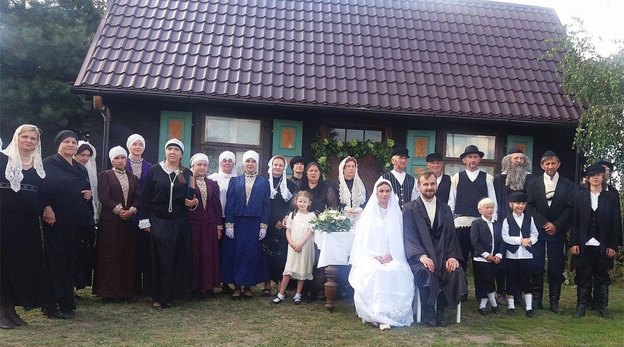 Villagers attend a fake Jewish wedding the Polish village of Radzanow on Aug. 5.
