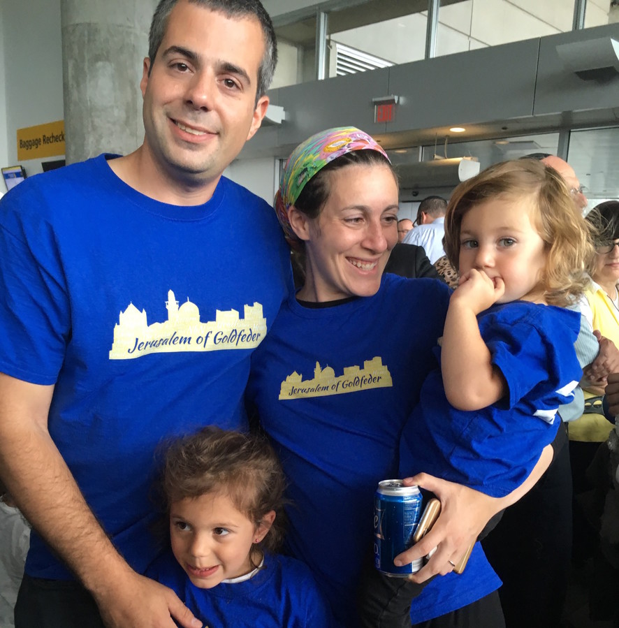 The Goldfeders of Kew Gardens Hills went home to Israel on Monday. Chanoch and Chani and their children, Reut (left) and Elana, were among 233 slim on Nefesh B'Nefesh's second summer