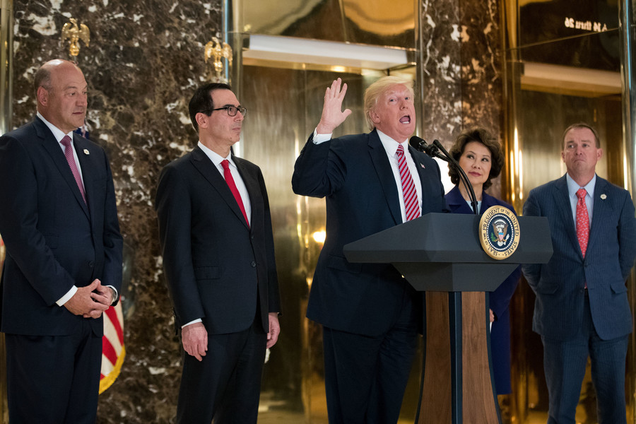 President Trump speaks with reporters in the lobby of Trump Tower on Tuesday, Aug. 15. Standing alongside him, from left: Director of the National Economic Council Gary Cohn, Treasury Secretary Steve Mnuchin, Transportation Secretary Elaine Chao and Director of the Office of Management and Budget Mick Mulvaney. He fielded questions about his comments on the events in Charlottesville, Virginia, and white supremacists.