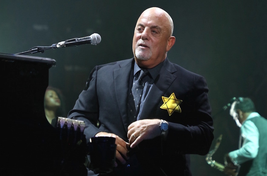 Billy Joel wears a jacket with the Star of David during the encore of his 43rd sold out show at Madison Square Garden on Aug. 21, 2017.