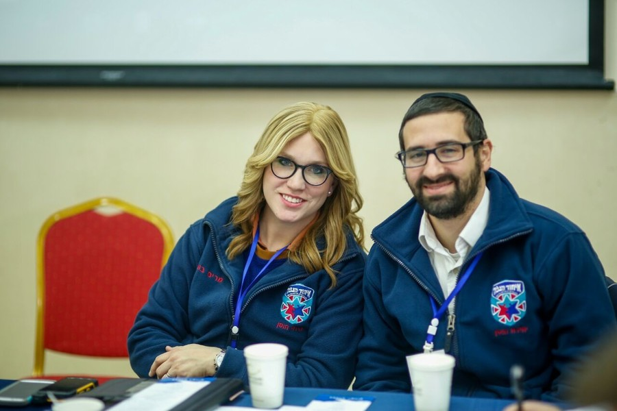 Miriam Ballin and her husband, Adam, sitting at United Hatzalah headquarters in Jerusalem.