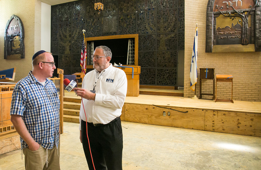 Nachum Segal in Houston's United Orthodox Synagogue with Rabbi Barry Gelman on Sept. 9.