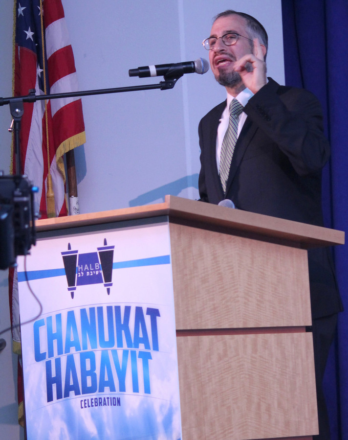 Rabbi Yisroel Kaminetsky speaks at Sunday's chanukat habayit at HALB's elementary school in Woodmere.