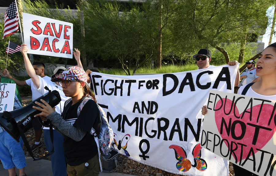 Immigrants and DACA supporters rally across the street from the Trump International Hotel & Tower in Las Vegas on Sept. 10.