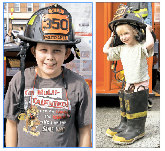 Among Five Towners taking part: Meyer Ginsberg, 11, tires on an authentic firefighter hat, and Ora Mandelbaum, 3, finds plenty of free space in the firefighter gear.