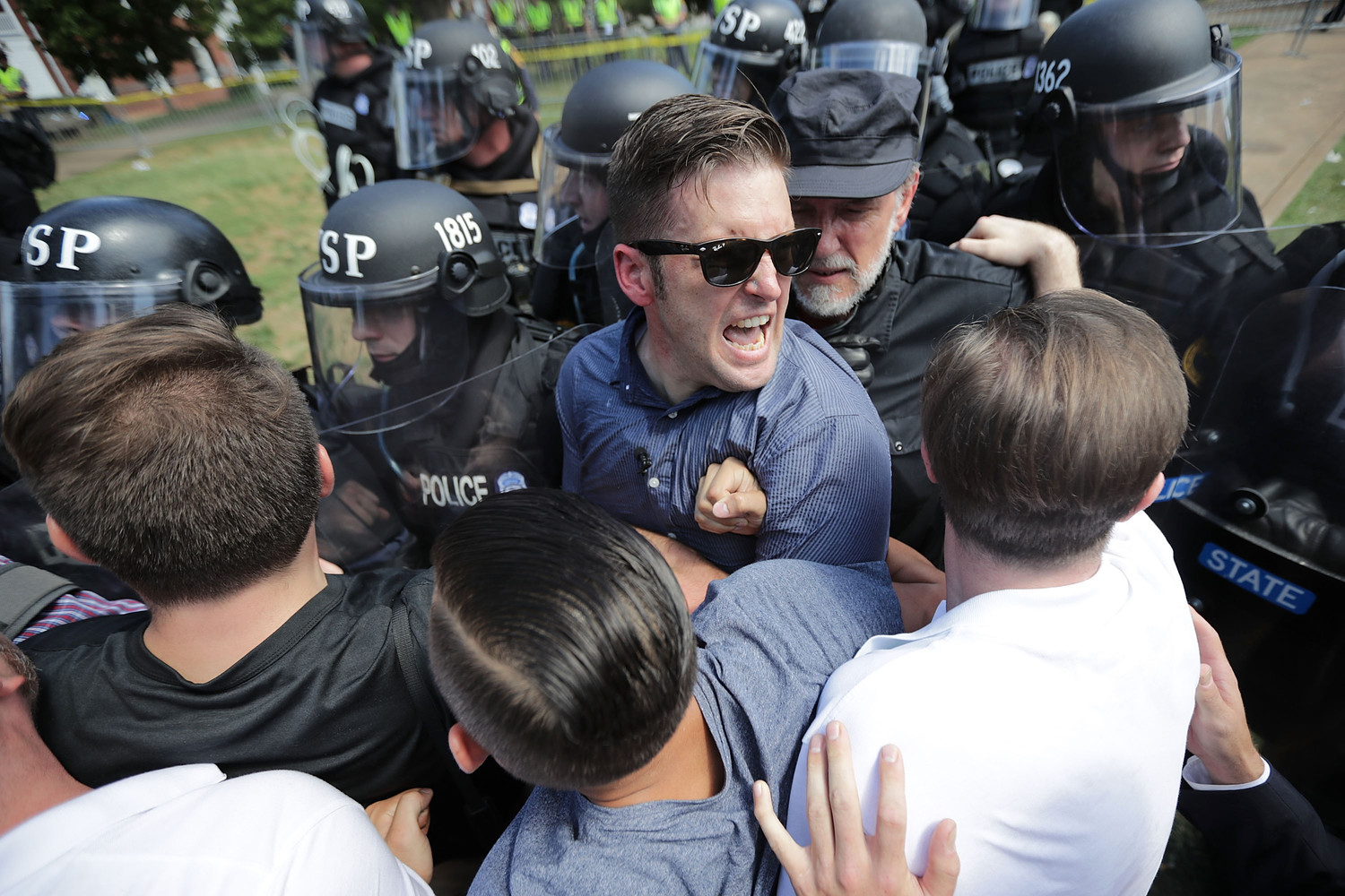 "White nationalist Richard Spencer and his supporters clash with Virginia State Police in Emancipation Park after the ""Unite the Right"" rally was declared an unlawful gathering Aug. 12, 2017 in Charlottesville, Virginia."