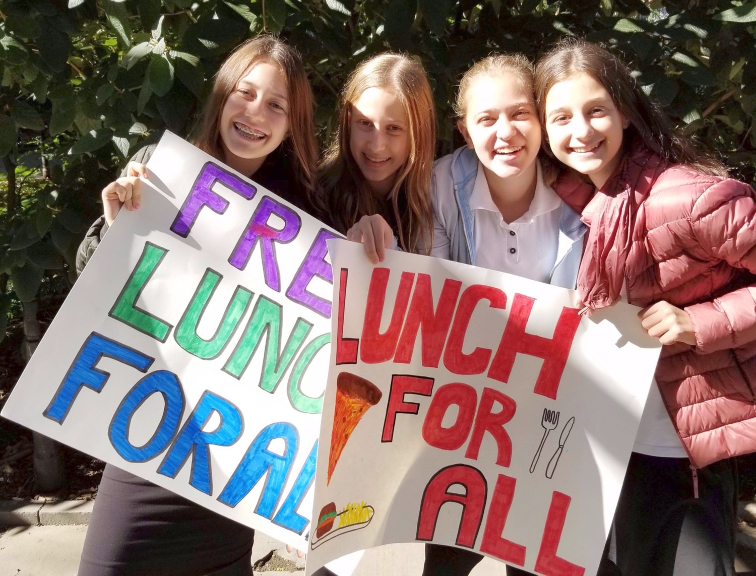 "Eighth grade girls from the Manhattan Day School gotet passionate about ""Free Lunch for All,"" outside City Hall in Lower Manhattan."