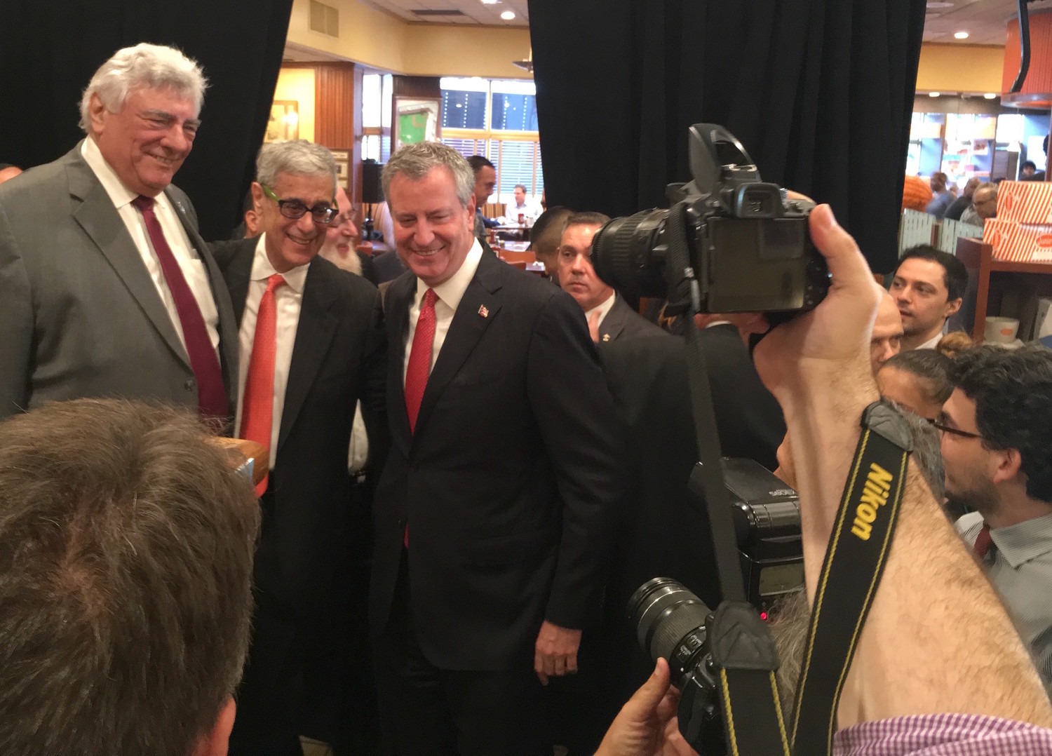 Steve Cohn is flanked by Mayor Bill deBlasio and Kings County Democrats chairman Frank Seddio.