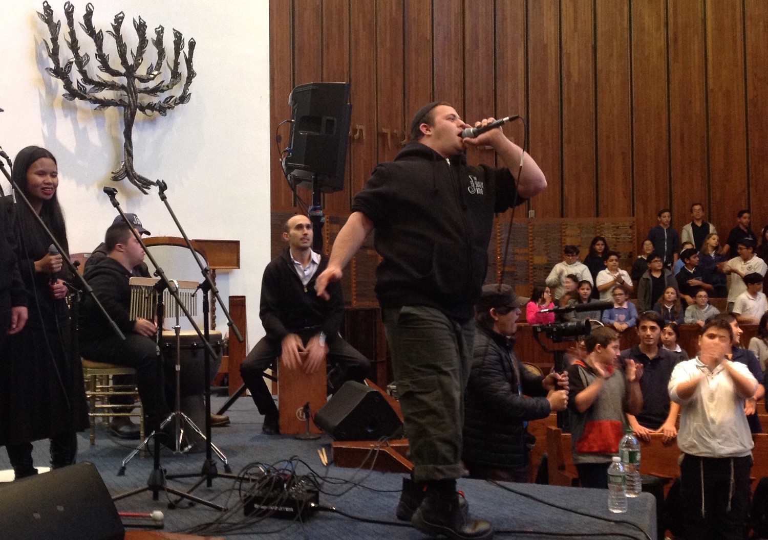 Yair Pomburg raps during a performance of the Shalva Band at the North Shore Hebrew Academy in Great Neck.