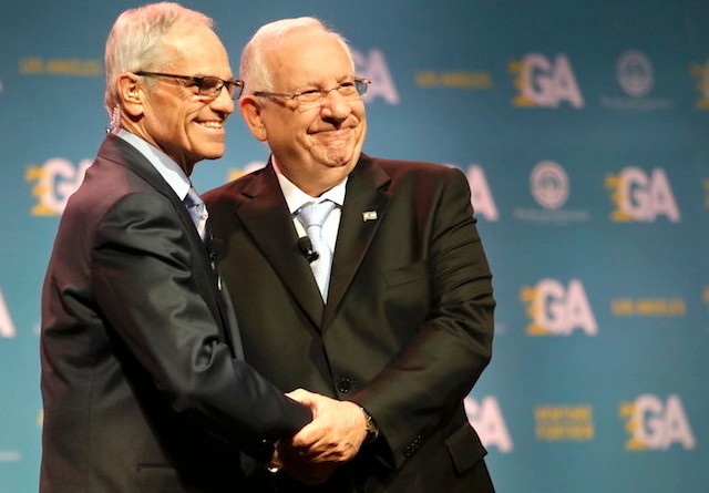 Israeli President Reuven Rivlin, right, shaking hands with Richard Sandler, board chairman of the Jewish Federations of North America, at the group's General Assembly in Los Angeles on Nov. 13.
