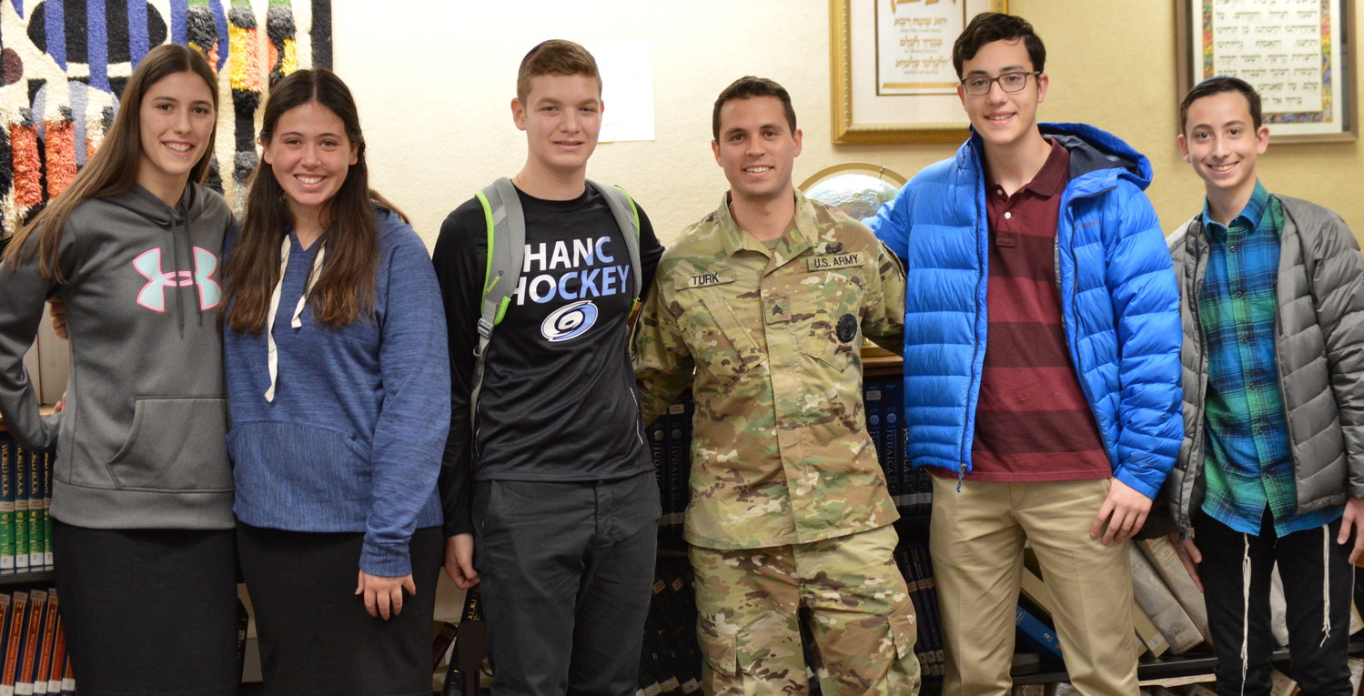 Sgt. Jason Turk, HANC alumnus, visited on Veterans Day to brief students on his experience in the U.S. military, which included missions in Afghanistan and his current position as a National Guard recruiter.