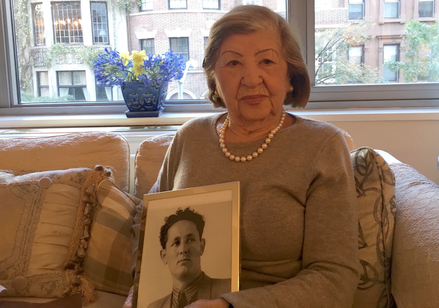 Rose Holm at her apartment holding a photo of her late husband, Joe, on Oct. 31.