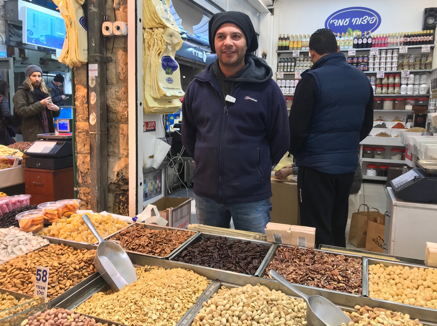 Bassam Hoshiah selling nuts at the Mahane Yehuda market in Jerusalem, Dec. 6, 2017.