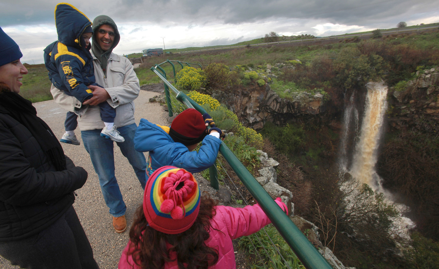 An Israeli family views Ayit Falls near the town of Katzrin on the Golan Heights.