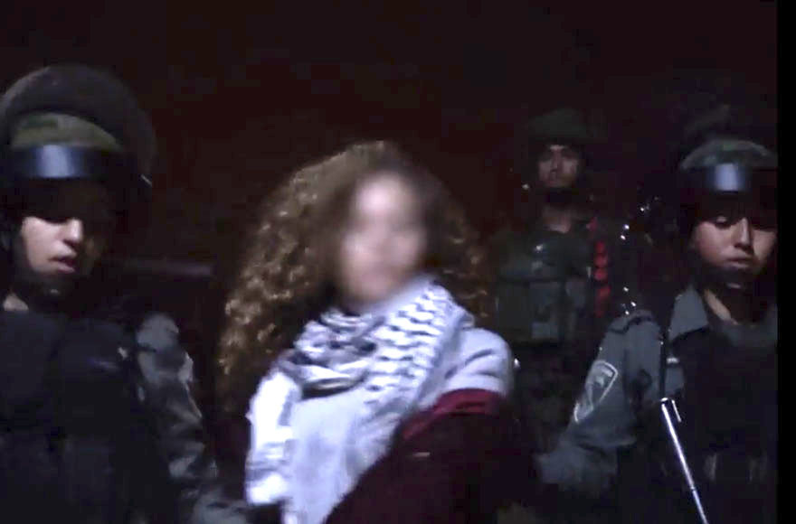 Palestinian girl filmed trying to provoke soldiers to remain in Israeli jail