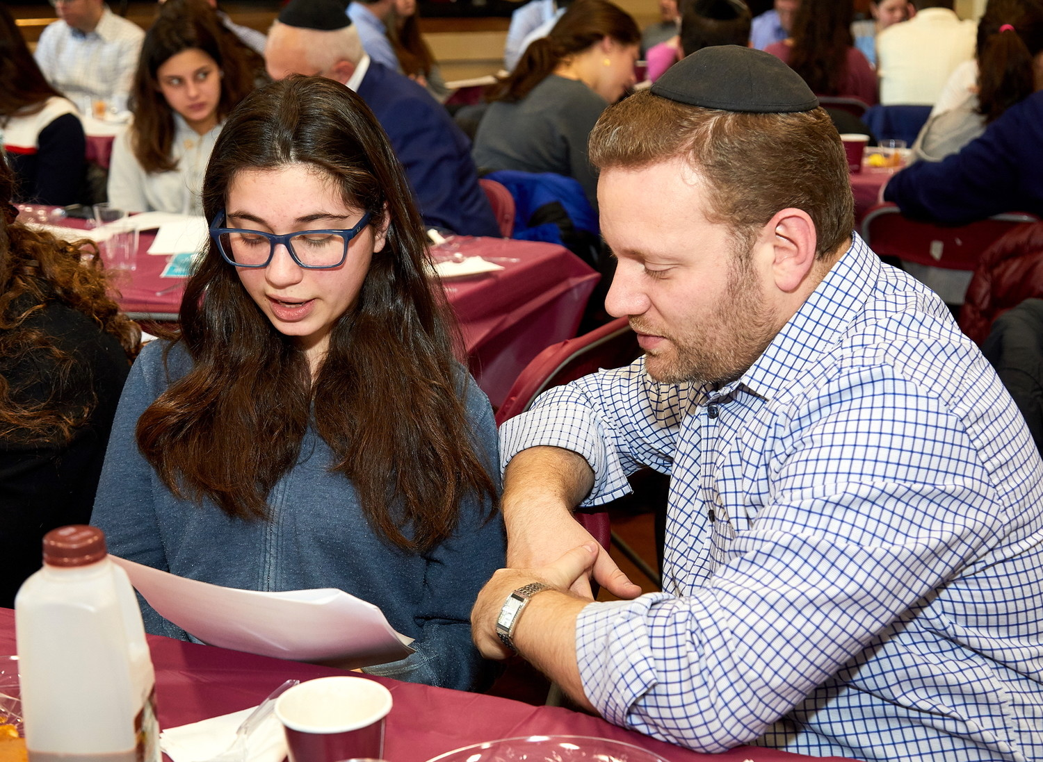 SKA ninth grader Priva Halpert studies with her father, Dr. Eliezer Halpert, at the school's father-daughter breakfast.