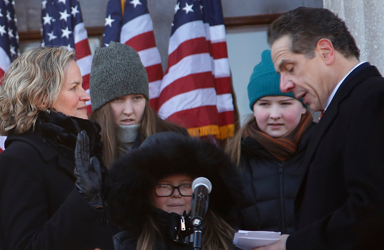 Gov. Andrew Cuomo administers the oath of office to Nassau's new County Executive, Laura Curran, on the steps of the legislative building in Mineola on Jan. 1.