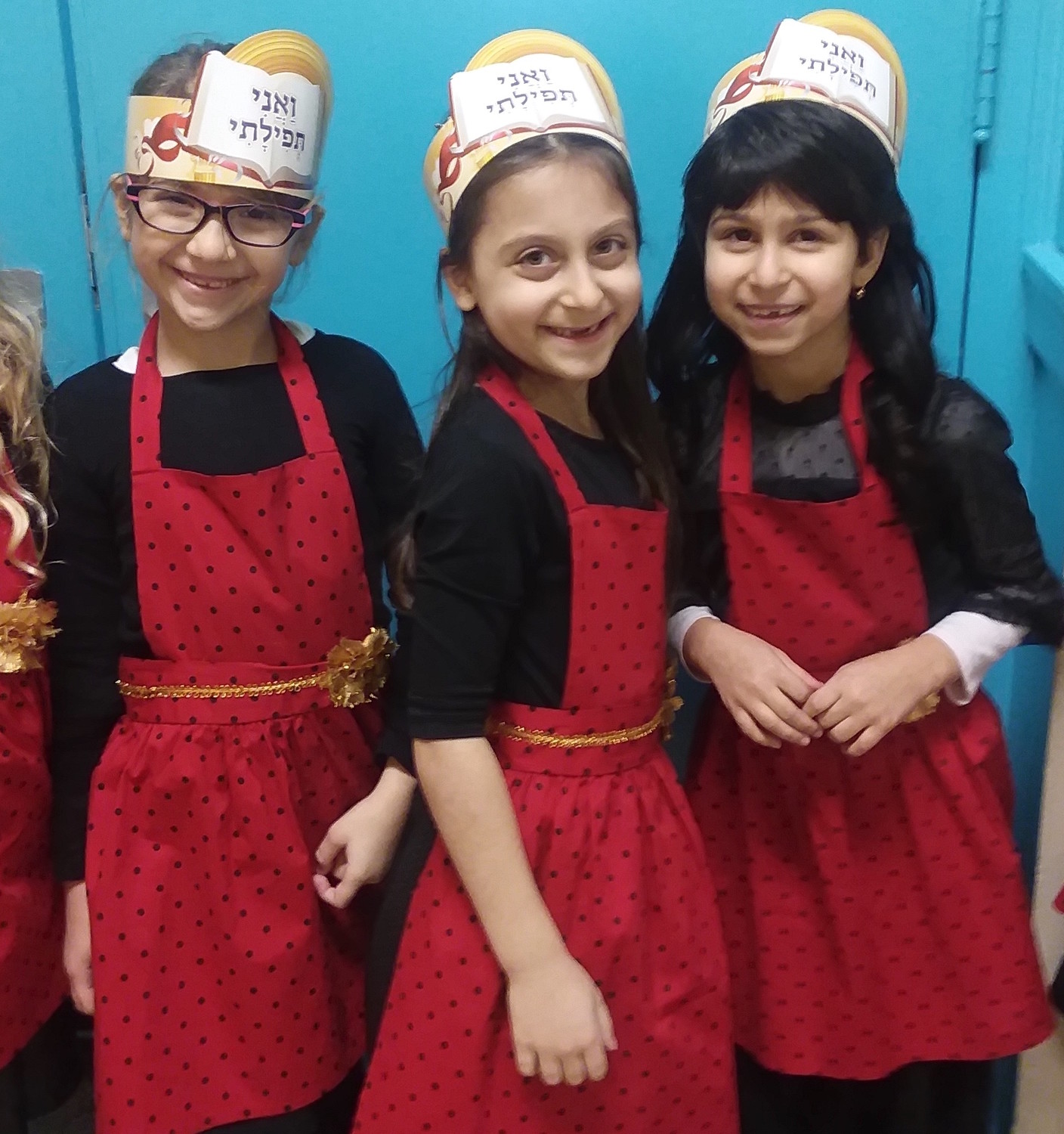 From left: Tohar Kobi, Lauren Greene, and Ahava Babayev, excited to receive their first siddurim.