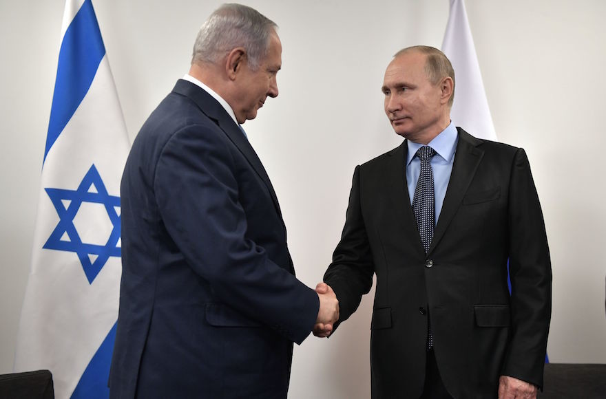 Russian President Vladimir Putin greets Israeli Prime Minister Benjamin Netanyahu at the Jewish Museum and Tolerance Center in Moscow Jan. 29