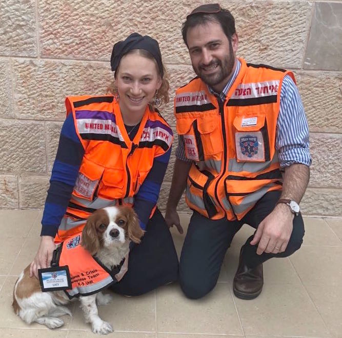 Batya and Moshe Jaffe with their Psychotrauma and Crisis Response Unit K-9 Lucy.