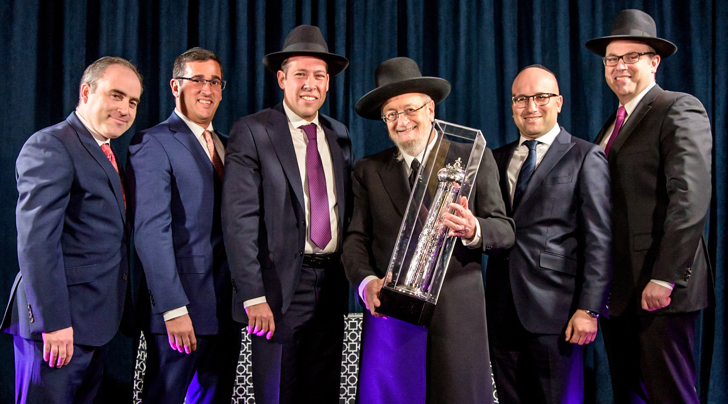 At the Kehillas Bais Yehuda Tzvi of Cedarhurst dinner, from left: Dinner chairs Daniel Burg and Michael Greenfield; former president Tuli Tepfer; Harav Feitman; dinner co-chair Eli Moskowitz, and president Ari Hahn.