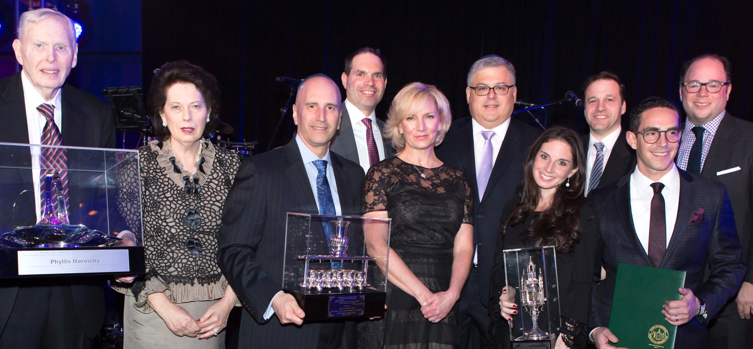 Pictured, front row from left: Murray Horowitz and his wife, Educator of the Year honoree Phyllis Horowitz; Guests of Honor Arthur and Lisa Perl; and Young Leadership awardees Ariella and Ari Gasner. Back row from left: Chairman of the Board Neil Wiener; HAFTR President Yaron Kornblum, Executive Director Ari Solomon, and Dinner Chairman Josh Glatt.