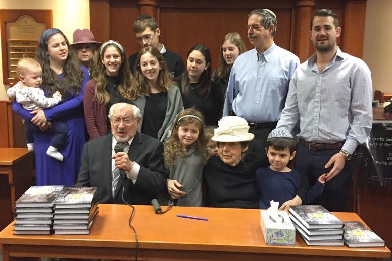 "Young Israel of Lawrence-Cedarhurst member Moshe Rubin, accompanied by his wife Elaine, children, grandchildren and great-grandchildren, at the launch of his book, ""Plucked from Fire,"" at the shul."