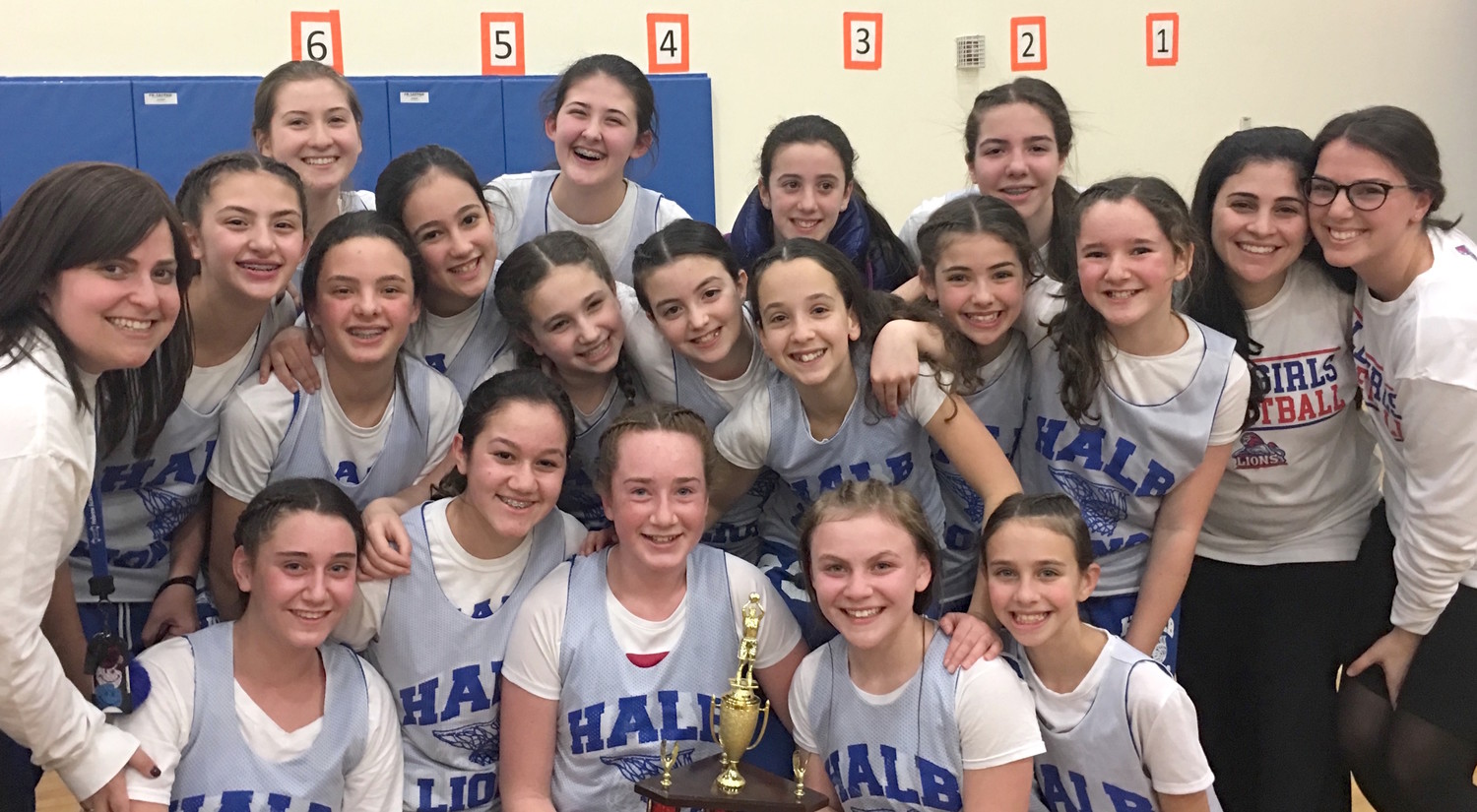 HALB's happy team — back row: Kayla Muchnick, Helaina Singer, Emily Froleich (manager), and Danielle Abelson; middle row: Morah Farbman, Ahuva Singer, Leora Konig, Leora Ellenberg, Chloe Dershowitz, Kayla Wang, Rebecca Brown, Meghan Gottfried, Kayla Goldberg, and  coaches Sara Fellus and Gabi Mlotok; front row: Naomi Sigman, Atara Sicklick (MVP), Simona Goldberg, Zahava Aryeh, and Jamie Feder.
