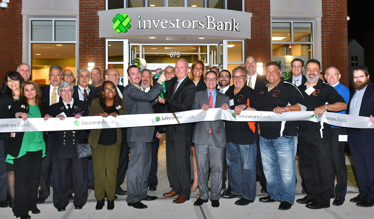 Branch Manager Daniel Clayton (center left) cut the ribbon at Investors Bank's branch at 675 Hempstead Tpke. near West Hempstead.